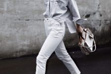 08 a trendy summer outfit with white jeans, an oversized thin stripe button down, white slipper loafers and a white bag is suitable for work