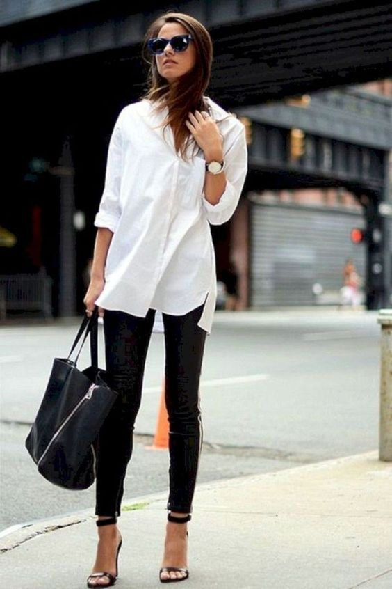 a white button down, black skinnies, black shoes and a large black bag