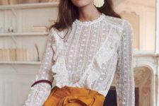 08 a white lace blouse with ruffles and long sleeves, mustard high waisted pants and a burgundy round bag