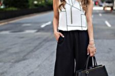 08 a white sleeveless geometric top, black culottes, black ankle strap shoes and a blakc tote