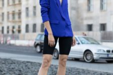 09 a bold blue oversized blazer, black bike shorts, black ankle strap shoes