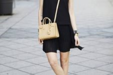 09 a comfy black sleeveless dress, white loafers with black bottoms and a tan bag
