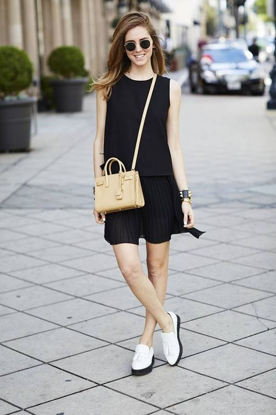 a comfy black sleeveless dress, white loafers with black bottoms and a tan bag
