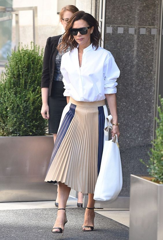 a modern look with a white button down, a striped pleated midi skirt, black heels and a white tote