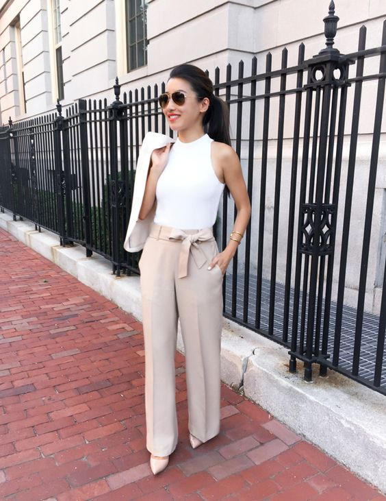 a white halter neckline top, tan pants with a bow on the waist, nude heels for a preppy summer look