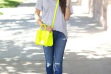 09 an oversized grey tee, blue ripped jeans, white sneakers, a neon yellow bag