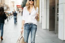 09 blue ripped jeans, a white shirt, a black bra under it, a nude bag and nude and black slingbacks