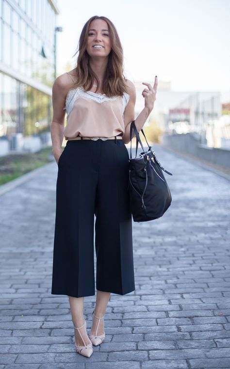 navy culottes, a blush top with a lace rim, nude vintage-inspired shoes and a black bag