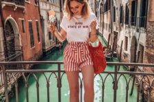 09 striped red and white high waisted shorts, a graphic tee, white loafers and a woven bag for a bright look