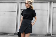 10 a modern look with a black turtleneck tee, black asymmetrical skirt and white sneakers