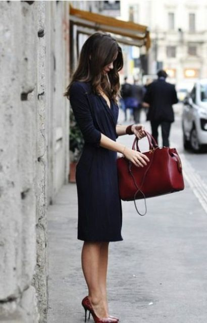 a structural burgundy bag is a bold touch to your outfit and a chic feel