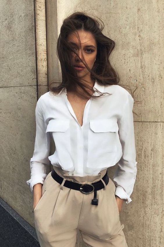 camel high waisted pants, a black belt and a white button down with pockets for work