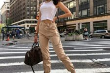10 tan cargo pants, a white crop top, white sneakers and a blck for ultimate comfort