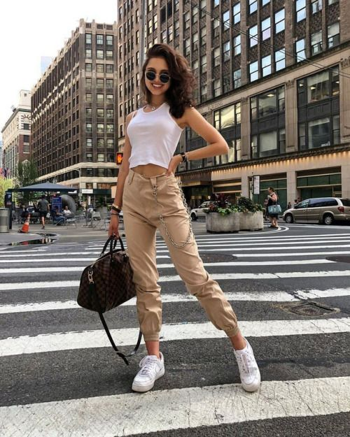 tan cargo pants, a white crop top, white sneakers and a blck for ultimate comfort