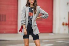 11 a printed tee, black bike shorts, polka dot slingbacks and a grey checked blazer plus a red bag