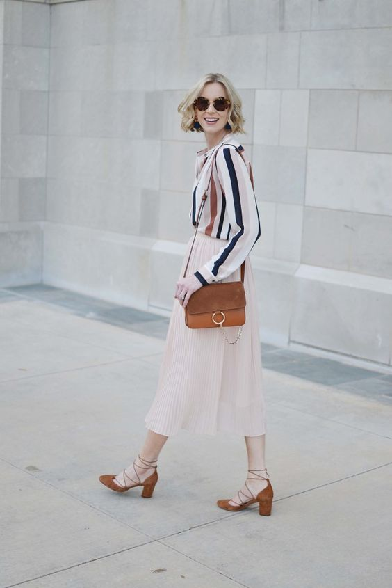 a striped button down, a blush pleated midi, rust lace up shoes and a matching bag