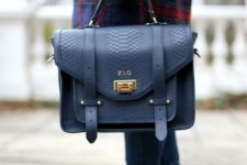 11 a structural navy leather bag with a snake texture and gold touches is a chic and bold idea