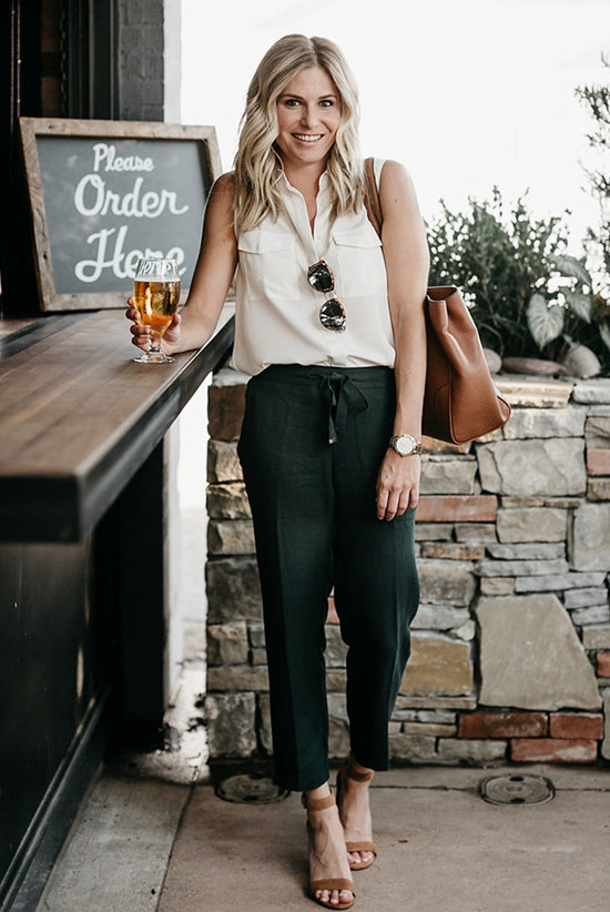 a white pocket sleeveless button down, black cropped pants, camel shoes and a camel tote