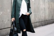 11 a white t-shirt is paired with an embellished olive green coat, distressed skinny jeans, snakeskin mules, and a black bag