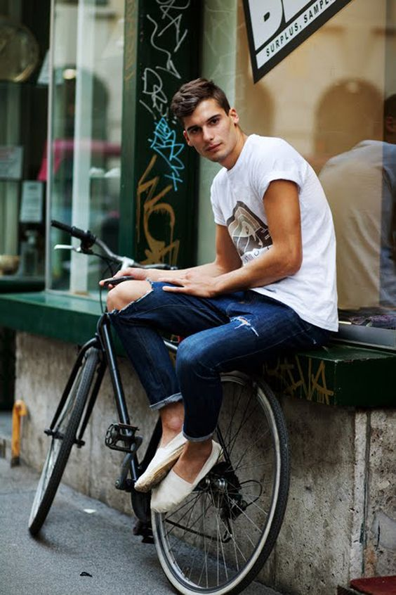 a white tee, blue jeans and white espadrilles will keep you comfy on a hot summer day