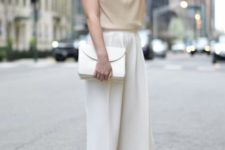 11 white culottes, a tan top with short sleeves, nude shoes and a white clutch make up a very comfy look