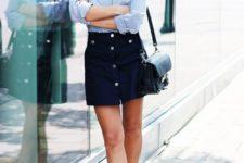 12 a striped blue button down, a black button down mini, white sneakers and a small black bag