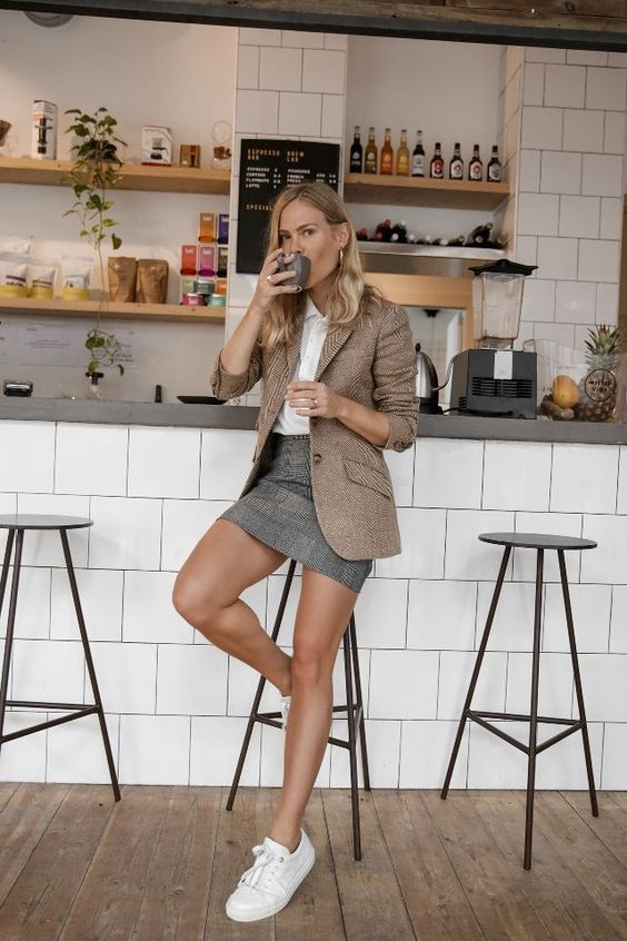 a white button down, a tan blazer, a grey checked skirt, white sneakers for a modern work look