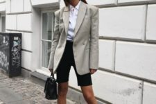 12 a white button down, black cycling shorts, a grey blazer, black pointed toe shoes and a black bag