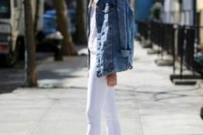 12 a white crochet top, black skinnies, a blue denim jacket and white slipper mules