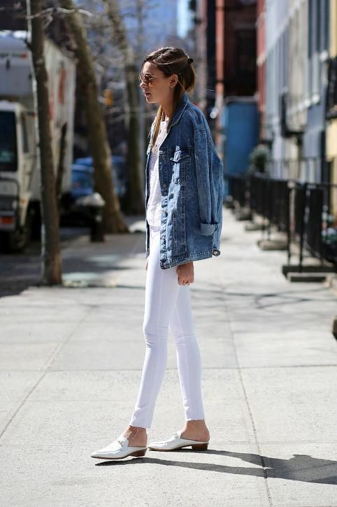 a white crochet top, black skinnies, a blue denim jacket and white slipper mules
