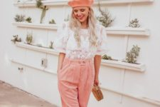 12 a white lace blouse with short sleeves, pink corduroy pants, a pink beret, white shoes