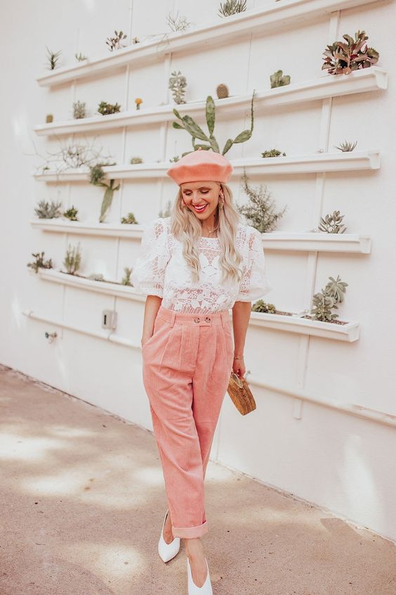 a white lace blouse with short sleeves, pink corduroy pants, a pink beret, white shoes