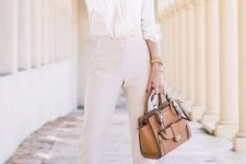 12 a white silk blouse, off-white high waisted cropped pants, camel shoes and a matching bag