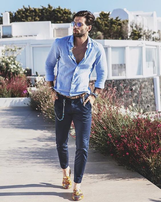 navy pants, a blue button down and colorful printed mules for a daring and sexy outfit