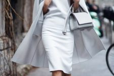 13 a chic look with a white knee dress, a matching cape, white strappy shoes and a white bag