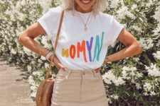 13 a graphic t-shirt, a tan denim mini skirt, a wicker round bag and round glasses for summer