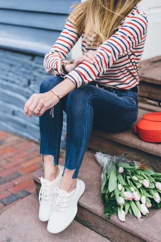 a striped top, blue skinnies, white sneakers for a spring casual look