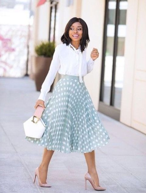a white blouse with a bow, a mint green polka dot midi skirt, nude heels and a whimsy bag