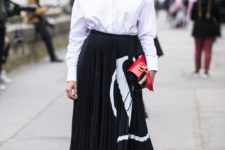 13 a white button down, a black and white patterned pleated midi, black boots and a catchy bag