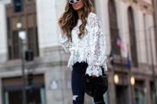 13 a white lace blouse with wide sleeves, black ripped skinnies, black ankle strap shoes and a black wooden bag