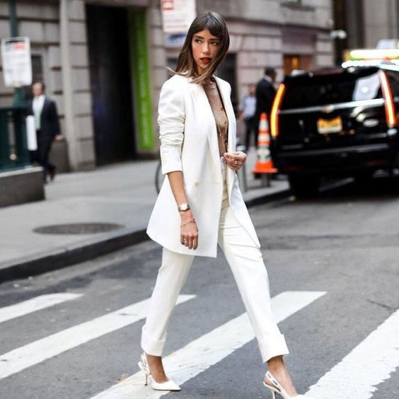 a white pantsuit, a tan top, white slingbacks are a ready office outfit to try