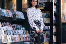 13 mixing prints with a striped shirt, a polka dot midi skirt and black and white mules