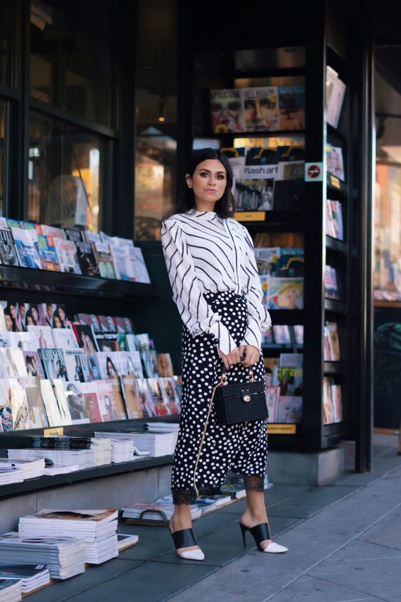 mixing prints with a striped shirt, a polka dot midi skirt and black and white mules