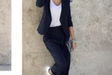 14 a black thin striped pantsuit, a white tee and white sneakers for a monochromatic work look