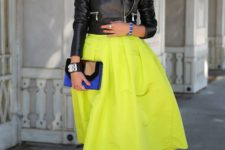 14 a cropped black leather jacket, a neon yellow midi A-line skirt, quirky heels and a blue and black clutch