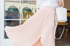 14 a white button down, a blush asymmetrical pleated midi, colorful pompom shoes and a bucket bag
