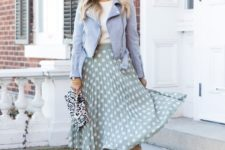 14 a white tee, a powder blue leather jacket, a green and white polka dot midi skirt, embellished heels and a printed clutch