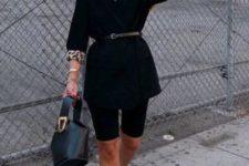 14 black bike shorts, a black thin belt ona  black blazer, printed pumps and a black bucket bag