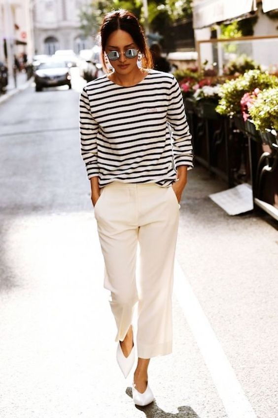 neutral pants, a striped top, white slingbacks and sunglasses for summer