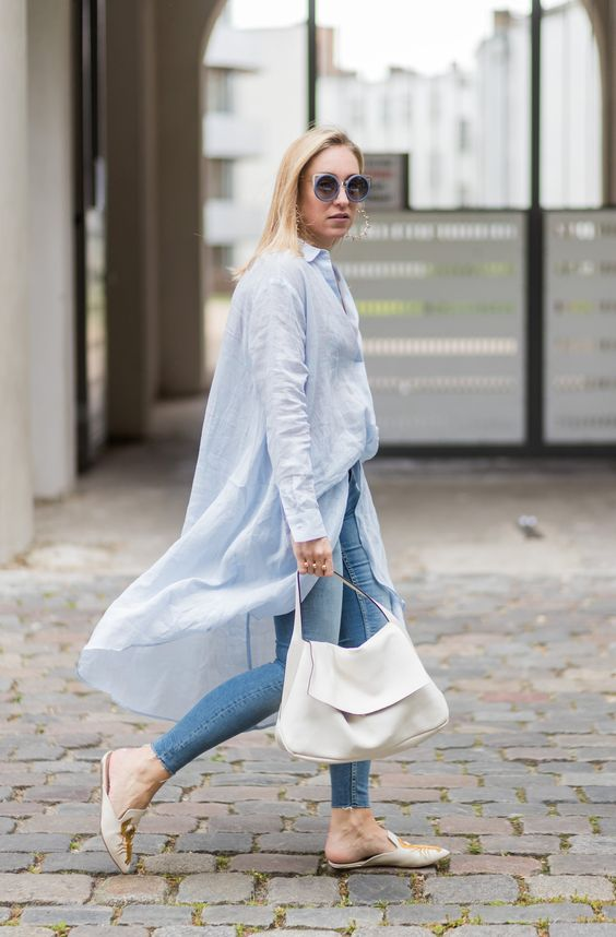 a blue tunic, blue skinnies, slipper mules and a white bag for a spring to summer look